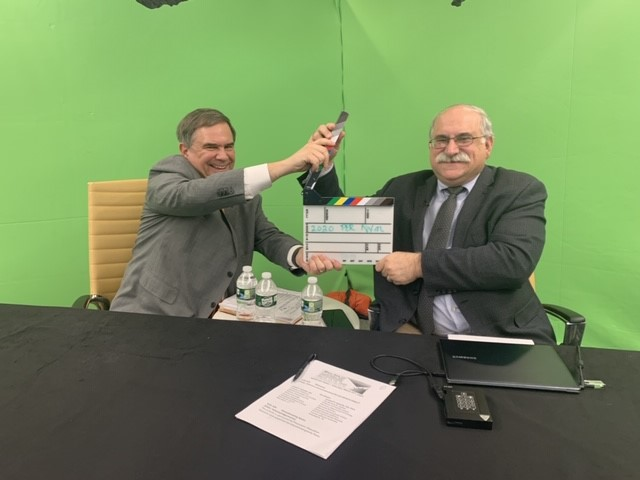 two doctors in front of a green screen