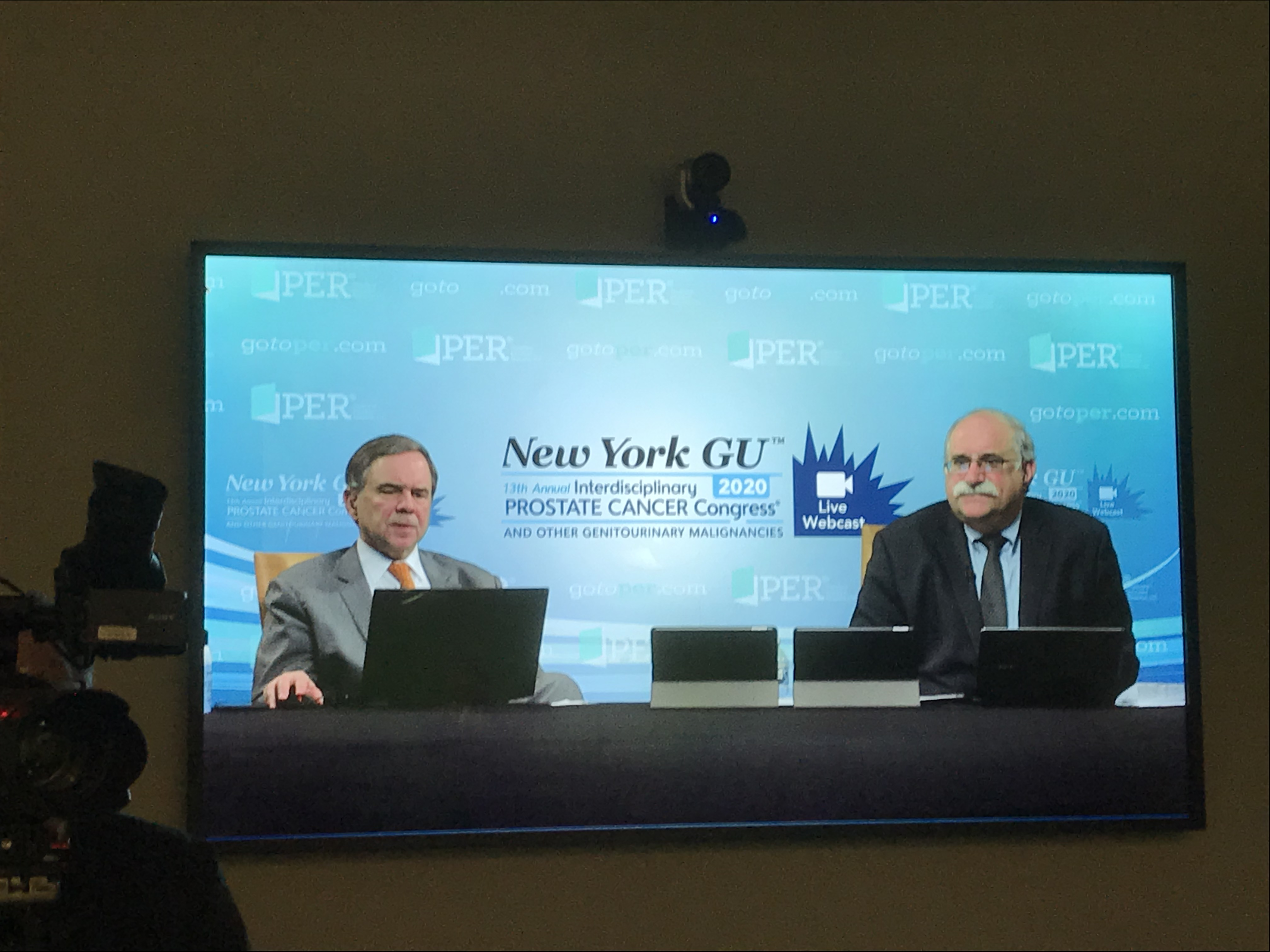 two doctors participating in a live webcast